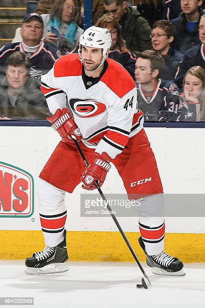 Jay Harrison of the Carolina Hurricanes skates with the puck against the Columbus Blue Jackets on January 10 2014 at Nationwide Arena in Columbus Ohio
