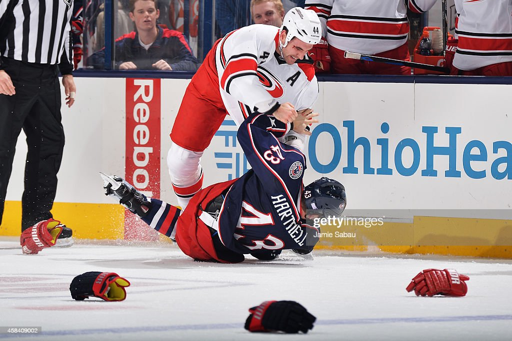 <a gi-track='captionPersonalityLinkClicked' href=/galleries/search?phrase=Jay+Harrison&family=editorial&specificpeople=714374 ng-click='$event.stopPropagation()'>Jay Harrison</a> #44 of the Carolina Hurricanes takes down <a gi-track='captionPersonalityLinkClicked' href=/galleries/search?phrase=Scott+Hartnell&family=editorial&specificpeople=201889 ng-click='$event.stopPropagation()'>Scott Hartnell</a> #43 of the Columbus Blue Jackets during a fight in the first period on November 4, 2014 at Nationwide Arena in Columbus, Ohio.