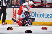 Jay Harrison of the Carolina Hurricanes takes down Scott Hartnell of the Columbus Blue Jackets during a fight in the first period on November 4 2014...