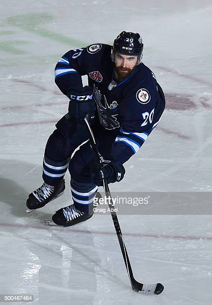 Jay Harrison of the Manitoba Moose controls the puck against the Toronto Marlies during AHL game action on December 5 2015 at the Ricoh Coliseum in...