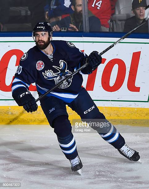 Jay Harrison of the Manitoba Moose turns up ice against the Toronto Marlies during AHL game action on December 5 2015 at the Ricoh Coliseum in...
