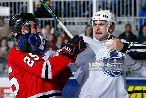 Jay Harrison of the Toronto Marlies gets rough with Cam Barker of the Rockford IceHogs at the Ricoh Coliseum November 18 2007 in Toronto Ontario...