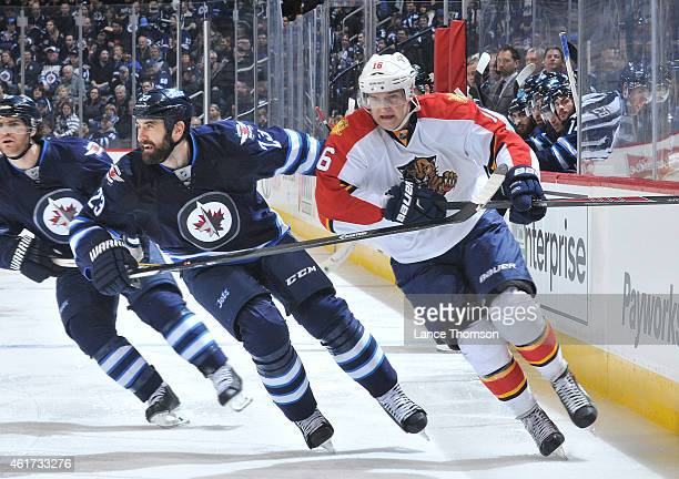 Jay Harrison of the Winnipeg Jets and Aleksander Barkov of the Florida Panthers follow the play down the ice during third period on January 13 2015...