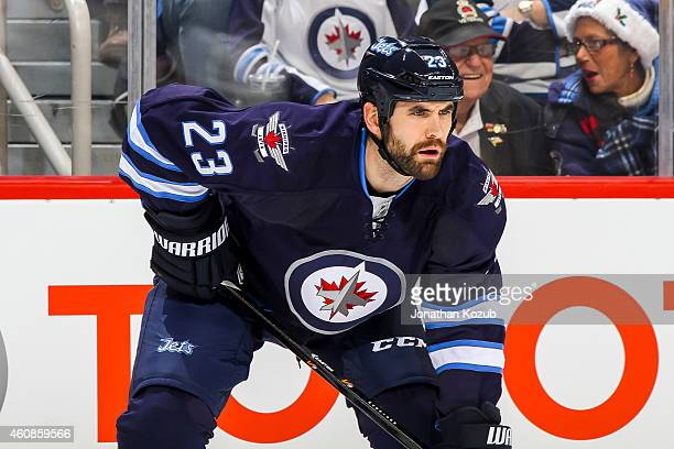 Jay Harrison of the Winnipeg Jets gets set during a first period faceoff against the Boston Bruins on December 19 2014 at the MTS Centre in Winnipeg...