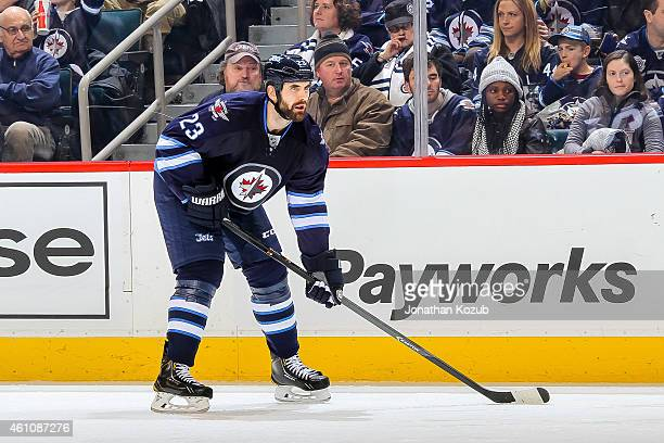 Jay Harrison of the Winnipeg Jets gets set during a third period faceoff against the Minnesota Wild on December 29 2014 at the MTS Centre in Winnipeg...