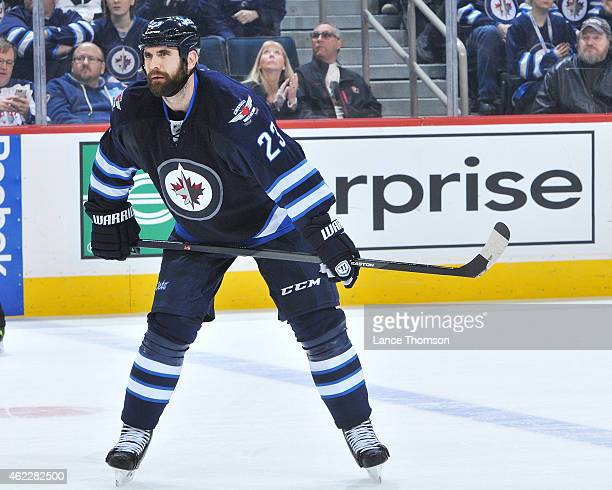 Jay Harrison of the Winnipeg Jets gets set for a third period faceoff against the Arizona Coyotes on January 18 2015 at the MTS Centre in Winnipeg...