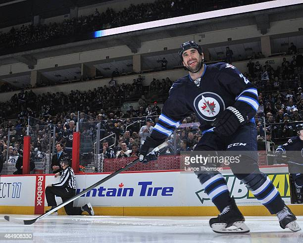 Jay Harrison of the Winnipeg Jets hits the ice prior to puck drop against the Dallas Stars on February 24 2015 at the MTS Centre in Winnipeg Manitoba...