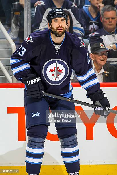 Jay Harrison of the Winnipeg Jets keeps an eye on the play during first period action against the Boston Bruins on December 19 2014 at the MTS Centre...