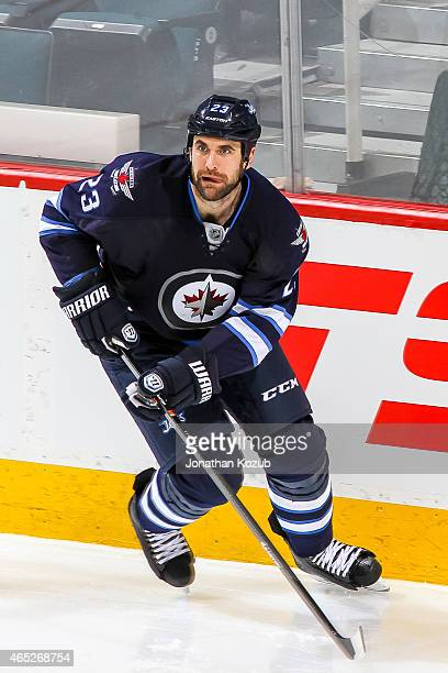 Jay Harrison of the Winnipeg Jets keeps an eye on the play during third period action against the St Louis Blues on February 26 2015 at the MTS...