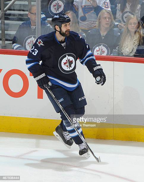 Jay Harrison of the Winnipeg Jets keeps an eye on the play during second period action against the St Louis Blues on March 19 2015 at the MTS Centre...