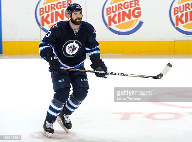 Jay Harrison of the Winnipeg Jets keeps an eye on the play during second period action against the Calgary Flames on April 11 2015 at the MTS Centre...