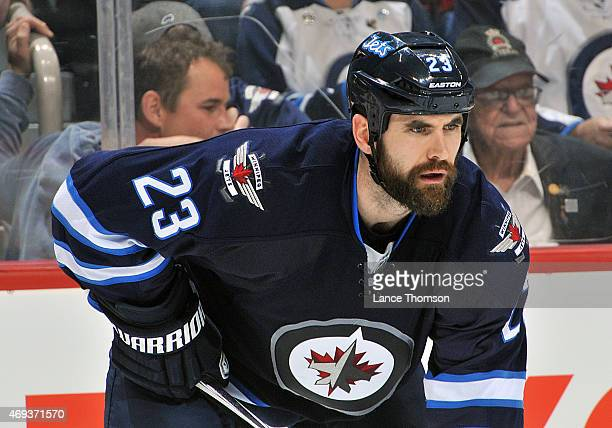 Jay Harrison of the Winnipeg Jets looks on during third period action against the Calgary Flames on April 11 2015 at the MTS Centre in Winnipeg...