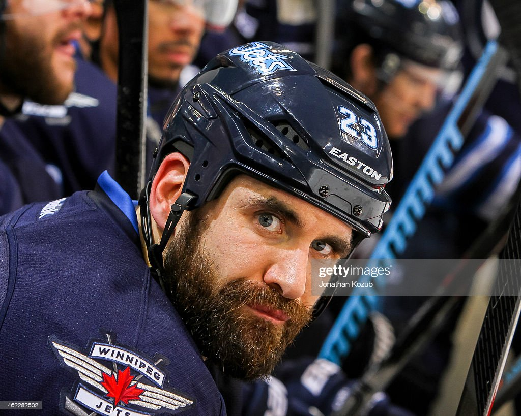 <a gi-track='captionPersonalityLinkClicked' href=/galleries/search?phrase=Jay+Harrison&family=editorial&specificpeople=714374 ng-click='$event.stopPropagation()'>Jay Harrison</a> #23 of the Winnipeg Jets looks on from the bench during second period action against the Arizona Coyotes on January 18, 2015 at the MTS Centre in Winnipeg, Manitoba, Canada. The Jets defeated the Coyotes 4-3 in the shootout.