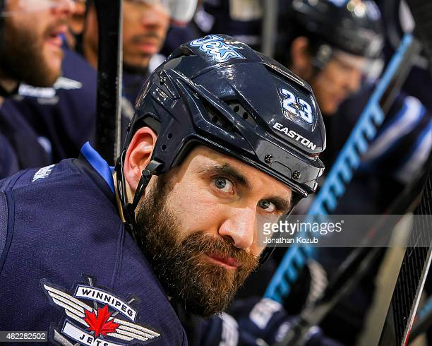 Jay Harrison of the Winnipeg Jets looks on from the bench during second period action against the Arizona Coyotes on January 18 2015 at the MTS...