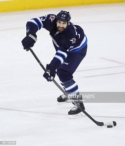 Jay Harrison of the Winnipeg Jets looks to pass the puck down the ice in first period action in an NHL game against the Toronto Maple Leafs at the...