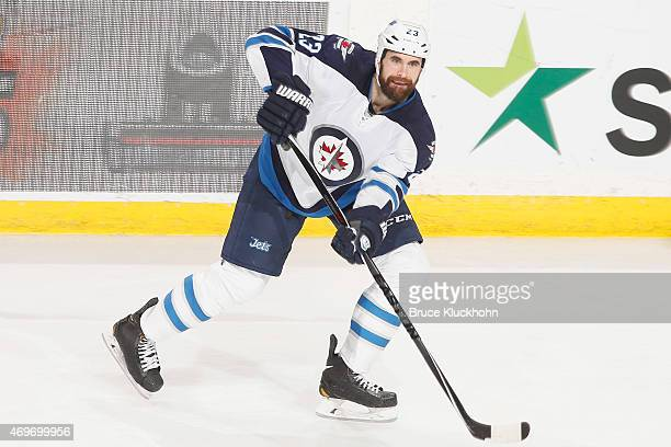Jay Harrison of the Winnipeg Jets passes the puck against the Minnesota Wild during the game on April 6 2015 at the Xcel Energy Center in St Paul...