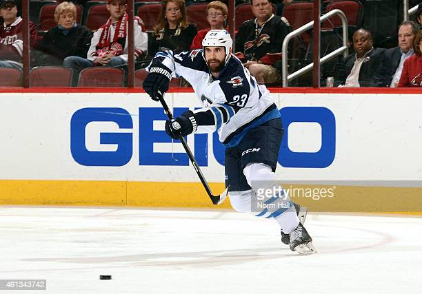 Jay Harrison of the Winnipeg Jets passes the puck up ice against the Arizona Coyotes at Gila River Arena on January 8 2015 in Glendale Arizona
