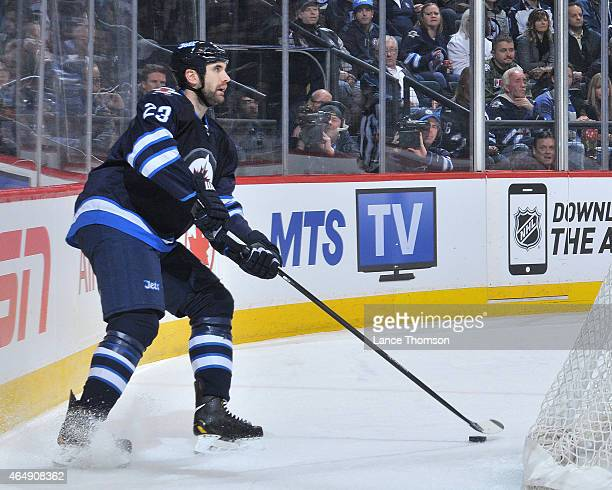 Jay Harrison of the Winnipeg Jets plays the puck behind the net during third period action against the Dallas Stars on February 24 2015 at the MTS...