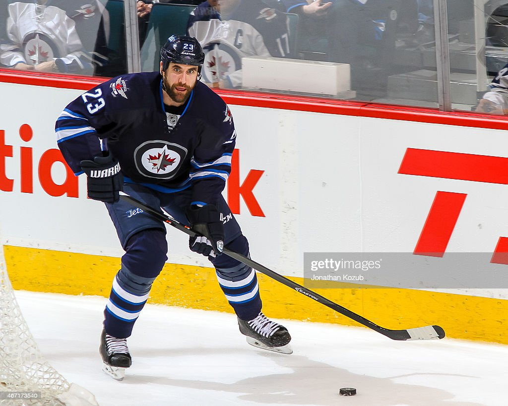 <a gi-track='captionPersonalityLinkClicked' href=/galleries/search?phrase=Jay+Harrison&family=editorial&specificpeople=714374 ng-click='$event.stopPropagation()'>Jay Harrison</a> #23 of the Winnipeg Jets plays the puck behind the net during third period action against the San Jose Sharks on March 17, 2015 at the MTS Centre in Winnipeg, Manitoba, Canada. The Jets defeated the Sharks 5-2.