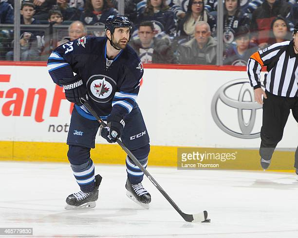Jay Harrison of the Winnipeg Jets plays the puck down the ice during third period action against the Ottawa Senators on March 4 2015 at the MTS...