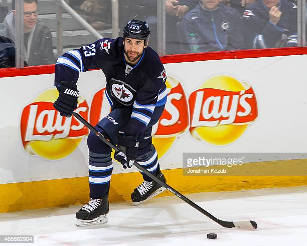 Jay Harrison of the Winnipeg Jets plays the puck up the ice during third period action against the Los Angeles Kings on March 1 2015 at the MTS...