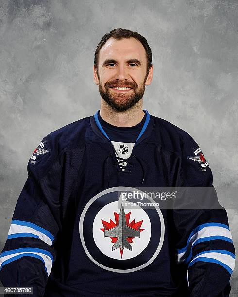 Jay Harrison of the Winnipeg Jets poses for his official headshot for the 20142015 season on December 20 2014 at the MTS Centre in Winnipeg Manitoba...