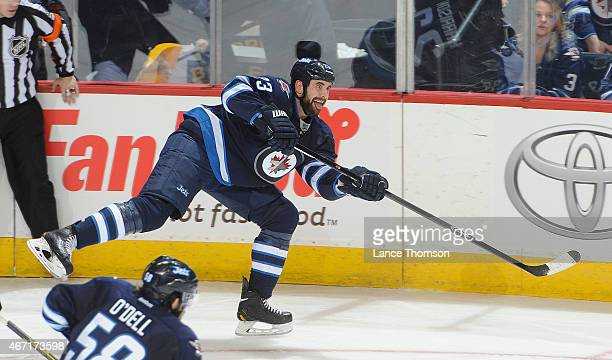 Jay Harrison of the Winnipeg Jets shoots the puck down the ice during second period action against the San Jose Sharks on March 17 2015 at the MTS...