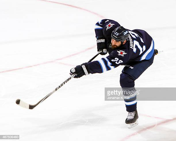Jay Harrison of the Winnipeg Jets shoots the puck down the ice during third period action against the St Louis Blues on March 19 2015 at the MTS...