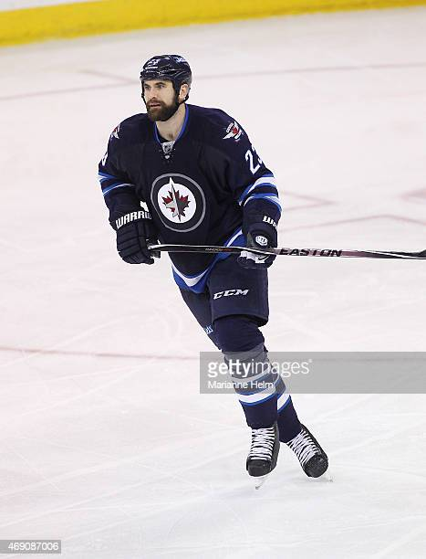 Jay Harrison of the Winnipeg Jets skates down the ice during thirdperiod action in an NHL game against the Vancouver Canucks at the MTS Centre on...