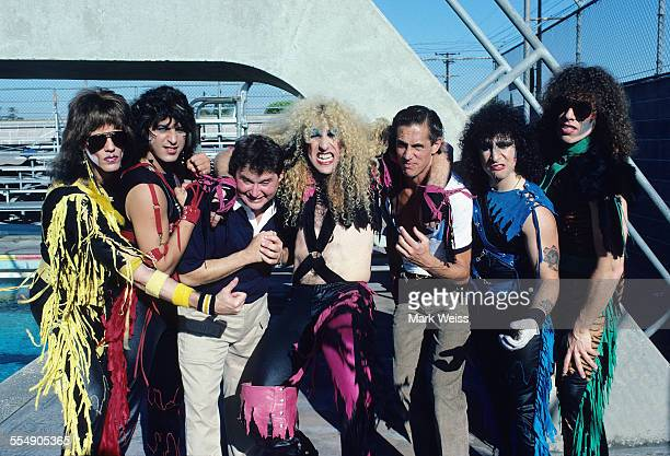 Jay Jay French Eddie Ojeda Dee Snider AJ Pero and Mark Mendoza of Twisted Sister with Stephen Furst and Mark Metcalf on the set of the video shoot...