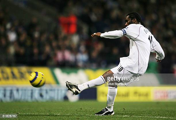 Jay Jay Okocha of Bolton Wanderers shoots in action the Barclays Premiership match between Bolton Wanderers and Portsmouth at the Reebok Stadium in...