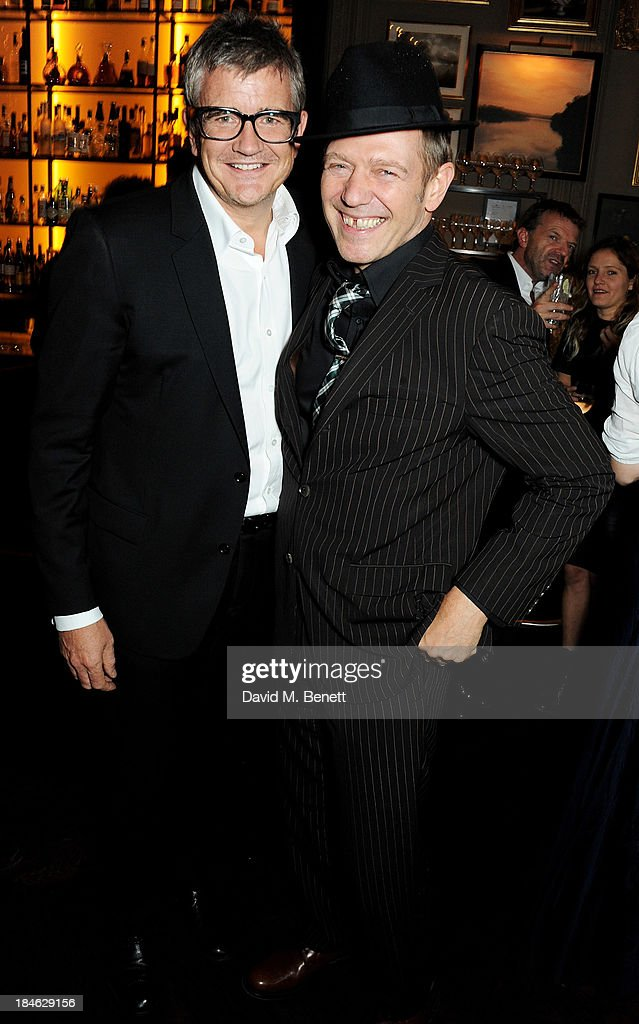 Jay Jopling (L) and Paul Simonon attend the London EDITION and NOWNESS dinner to celebrate ON COLLABORATION on October 14, 2013 in London, England.