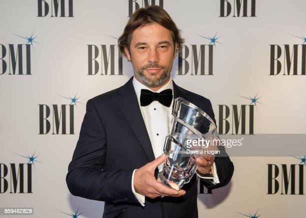 Jay Kay of Jamiroquai poses with the BMI President's Award which he was awarded at the BMI London Awards at The Dorchester on October 9 2017 in...