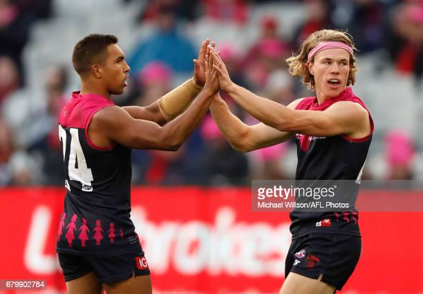 Jay KennedyHarris and Jayden Hunt of the Demons celebrate during the 2017 AFL round 07 match between the Melbourne Demons and the Hawthorn Hawks at...