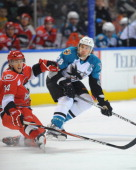 Jay Leach of the Worcester Sharks takes a shot against Brett Sutter of the Charlotte Checkers at the DCU Center on November 27 2010 in Worcester...