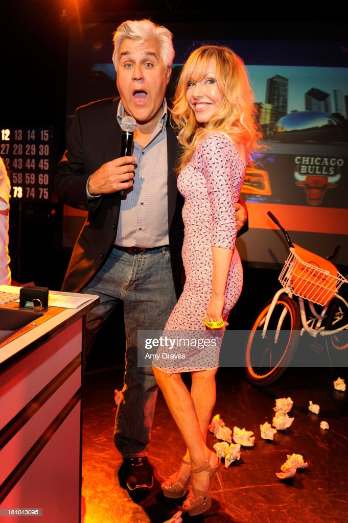 Jay Leno and Shelby Chong pose for a photo at Bingo At The Roxy to Benefit The Painted Turtle at The Roxy Theatre on October 10, 2013 in West Hollywood, California.