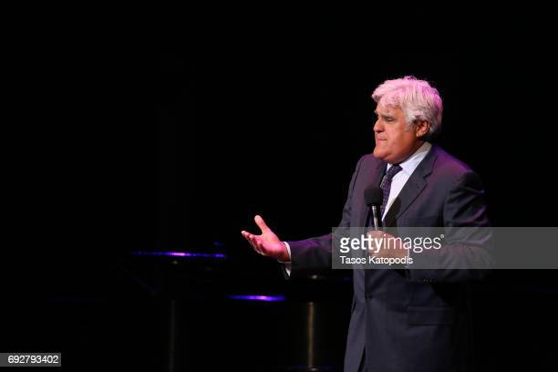 Jay Leno performs on stage during the National Night Of Laughter And Song event hosted by David Lynch Foundation at the John F Kennedy Center for the...