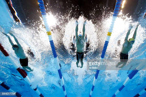 Jay Litherland Michael Phelps and Andrew Seliskar of the United States compete in a semifinal heat for the Men's 200 Meter Individual Medley during...