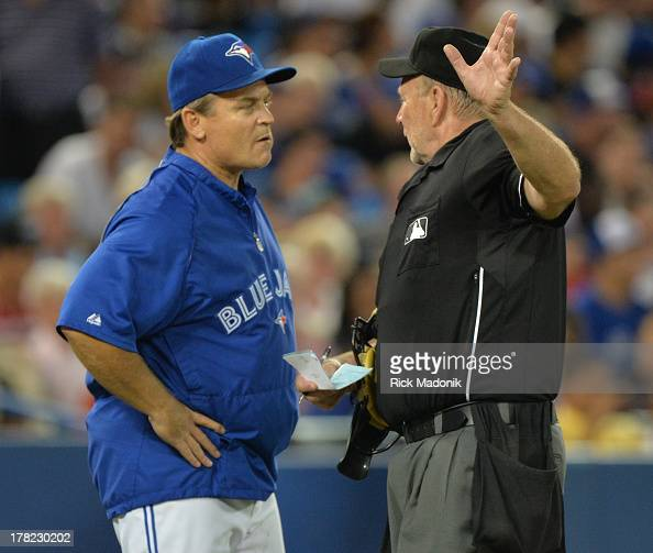 TORONTO ON AUGUST 27 Jay Manager John Gibbons chats with home ump Bob Davidson Toronto Blue Jays host New York Yankees at Roger's Centre in Toronto...