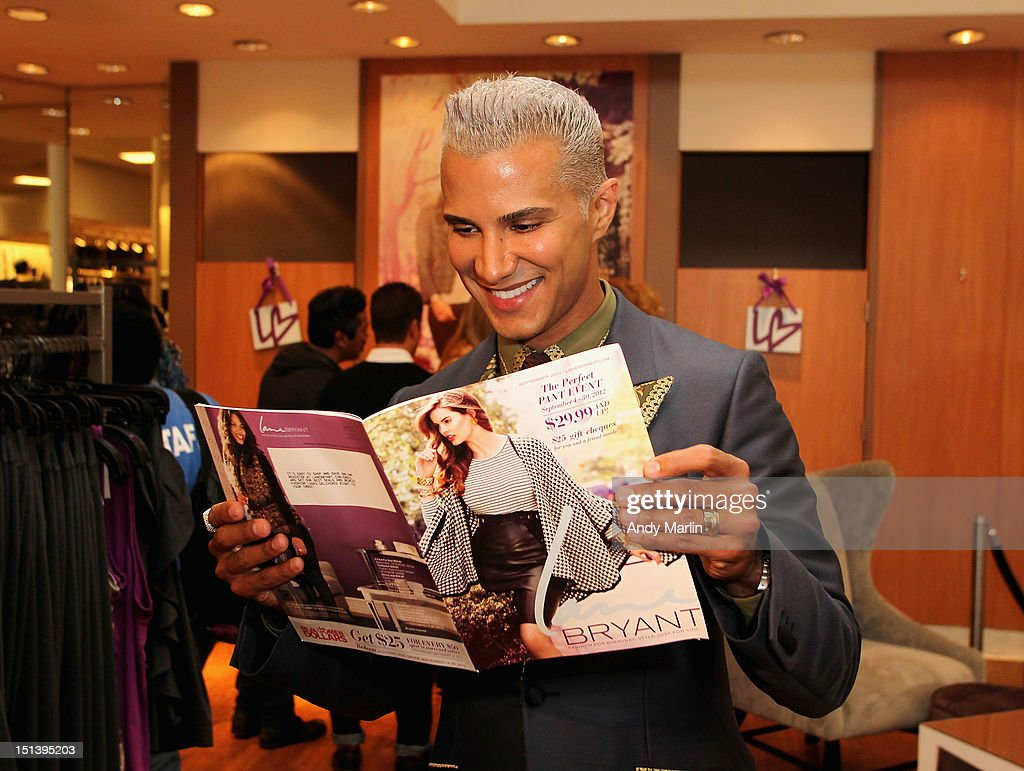 <a gi-track='captionPersonalityLinkClicked' href=/galleries/search?phrase=Jay+Manuel&family=editorial&specificpeople=557434 ng-click='$event.stopPropagation()'>Jay Manuel</a> looks through a Lane Bryant catalogue during Fashion Guru <a gi-track='captionPersonalityLinkClicked' href=/galleries/search?phrase=Jay+Manuel&family=editorial&specificpeople=557434 ng-click='$event.stopPropagation()'>Jay Manuel</a> Hosts Lane Bryant's Fashion Night Out on September 6, 2012 in Brooklyn, New York.