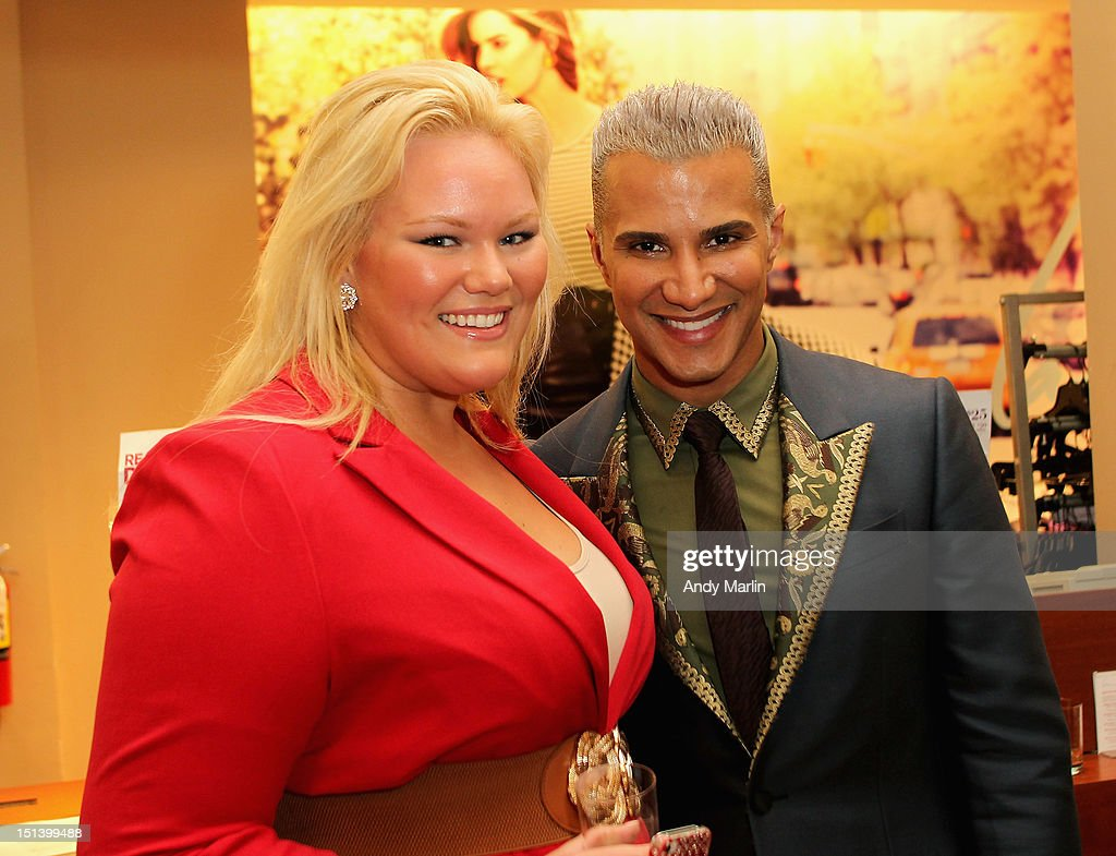Jay Manuel (R) poses for a photo with a guest during Fashion Guru Jay Manuel Hosts Lane Bryant's Fashion Night Out on September 6, 2012 in Brooklyn, New York.