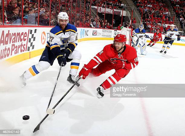 Jay McClement of the Carolina Hurricanes and Alex Pietrangelo of the St Louis Blues battle for the puck in the corner during their NHL game at PNC...