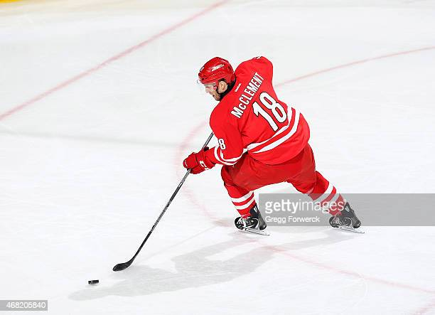 Jay McClement of the Carolina Hurricanes backhands a shot on net during their NHL game against the New Jersey Devils at PNC Arena on March 28 2015 in...