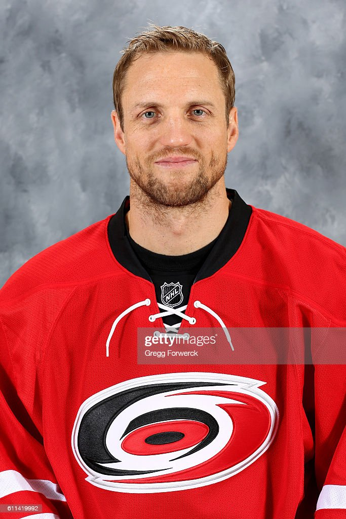 Jay McClement #18 of the Carolina Hurricanes poses for his official headshot for the 2016-2017 season on September 22, 2016 at Carolina Family Practice and Sports Medicine in Raleigh, North Carolina.