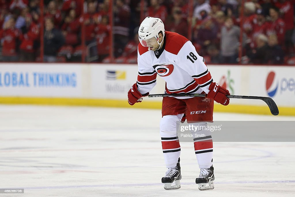 Jay McClement #18 of the Carolina Hurricanes reacts to a goal scored by the Washington Capitals at Verizon Center on March 31, 2015 in Washington, DC. The Washington Capitals won, 4-2.