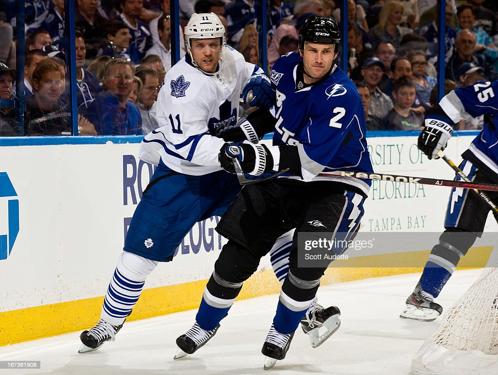 Jay McClement #11 of the Toronto Maple Leafs battles for position with <a gi-track='captionPersonalityLinkClicked' href=/galleries/search?phrase=Eric+Brewer&family=editorial&specificpeople=202144 ng-click='$event.stopPropagation()'>Eric Brewer</a> #2 of the Tampa Bay Lightning during the second period of the game at the Tampa Bay Times Forum on April 24, 2013 in Tampa, Florida.