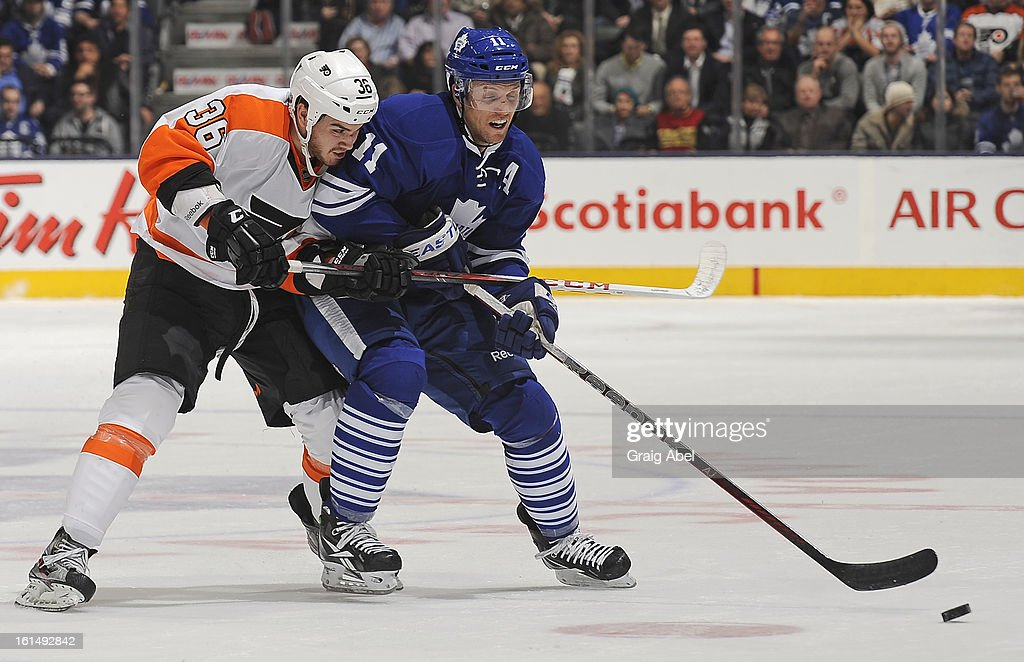 <a gi-track='captionPersonalityLinkClicked' href=/galleries/search?phrase=Jay+McClement&family=editorial&specificpeople=575233 ng-click='$event.stopPropagation()'>Jay McClement</a> #11 of the Toronto Maple Leafs battles for the puck with Zac Rinaldo #36 of the Philadelphia Flyers during NHL game action February 11, 2013 at the Air Canada Centre in Toronto, Ontario, Canada.