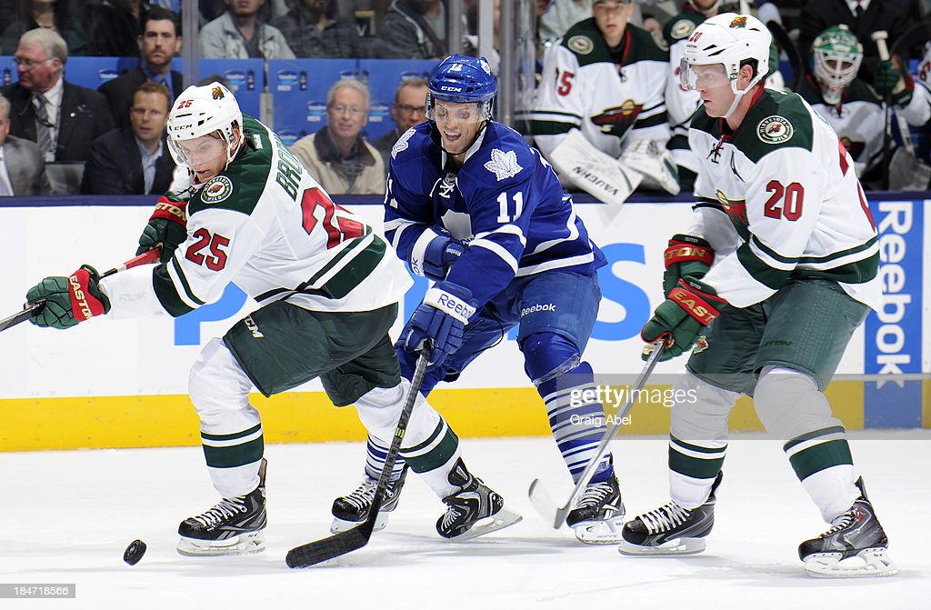 <a gi-track='captionPersonalityLinkClicked' href=/galleries/search?phrase=Jay+McClement&family=editorial&specificpeople=575233 ng-click='$event.stopPropagation()'>Jay McClement</a> #11 of the Toronto Maple Leafs battles for the puck with <a gi-track='captionPersonalityLinkClicked' href=/galleries/search?phrase=Jonas+Brodin&family=editorial&specificpeople=7832272 ng-click='$event.stopPropagation()'>Jonas Brodin</a> #25 and <a gi-track='captionPersonalityLinkClicked' href=/galleries/search?phrase=Ryan+Suter&family=editorial&specificpeople=583306 ng-click='$event.stopPropagation()'>Ryan Suter</a> #20 of the Minnesota Wild during NHL game action October 15, 2013 at Air Canada Centre in Toronto, Ontario, Canada.