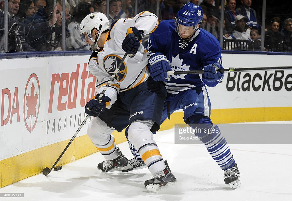 <a gi-track='captionPersonalityLinkClicked' href=/galleries/search?phrase=Jay+McClement&family=editorial&specificpeople=575233 ng-click='$event.stopPropagation()'>Jay McClement</a> #11 of the Toronto Maple Leafs battles for the puck with <a gi-track='captionPersonalityLinkClicked' href=/galleries/search?phrase=Corey+Tropp&family=editorial&specificpeople=5483748 ng-click='$event.stopPropagation()'>Corey Tropp</a> #78 of the Buffalo Sabres during NHL game action November 16, 2013 at the Air Canada Centre in Toronto, Ontario, Canada.