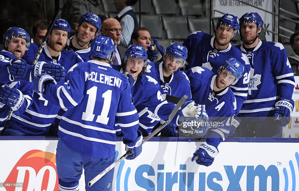 <a gi-track='captionPersonalityLinkClicked' href=/galleries/search?phrase=Jay+McClement&family=editorial&specificpeople=575233 ng-click='$event.stopPropagation()'>Jay McClement</a> #11 of the Toronto Maple Leafs celebrates a third period goal with teammates during NHL game action against the New Jersey Devils March 4, 2013 at the Air Canada Centre in Toronto, Ontario, Canada.